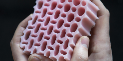 Holey Rubber Slab Has Controllable Stiffness